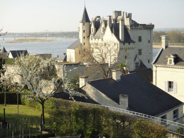 Turreted chateau of montsoreau before the loire valley river France