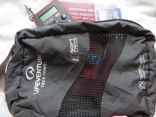 Passport holder for packing light