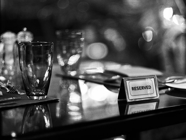 Eating out alone reserved sign