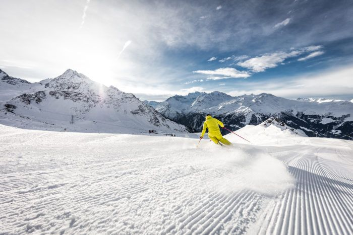 skiing in verbier in yellow ski suit