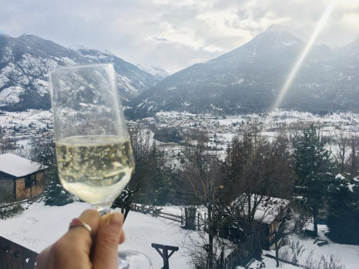 glass of wine with Verbier background