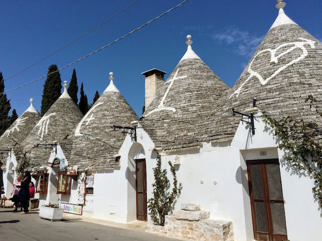 round white trulli houses with thatched roofs in Alberobello puglia italy