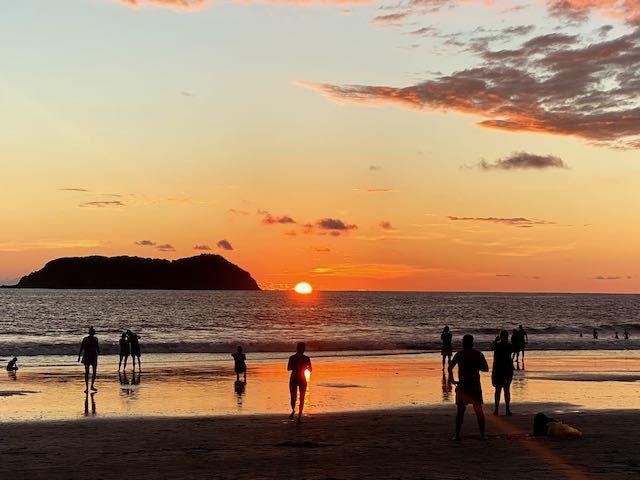 orange sunset over the beach in manuel antonio costa rica
